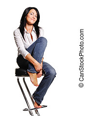Attractive woman sits on bar chair. Isolated on white