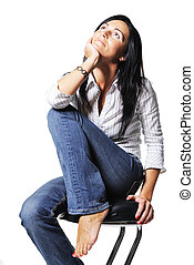 Attractive woman sits on chair. On white background