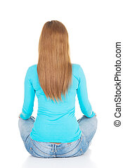 Attractive woman sitting. Back view.