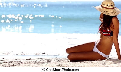 Attractive woman sitting in bikini