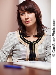 Attractive woman sitting in the office