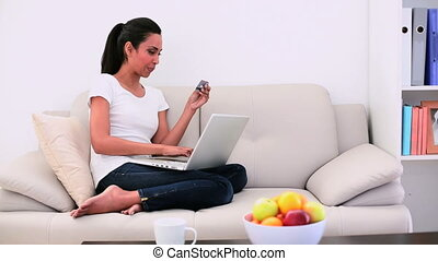 Attractive woman sitting on couch