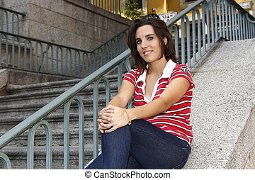attractive woman sitting on the floor