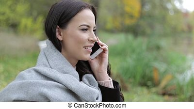 Attractive woman speaking on phone - Attractive woman in...