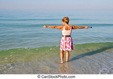 Woman Standing in the Ocean