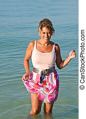 Attractive Woman Standing in the Surf