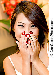 Attractive Woman - A young pretty asian woman laughing...