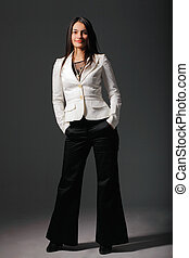 Attractive woman with her hands in one\'s pockets