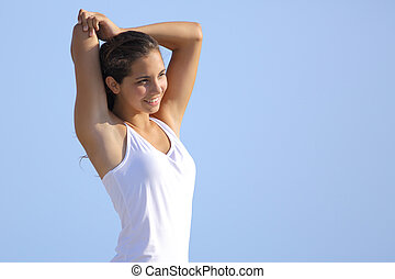 Attractive woman stretching arms outdoor