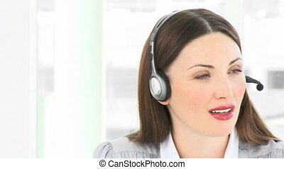 Attractive woman talking on a heads