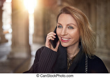Attractive woman talking on a smartphone
