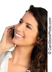 Attractive woman talking on phone
