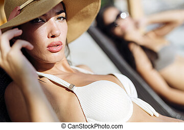 Attractive woman tanning on beach