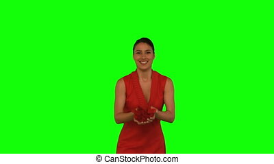 Attractive woman throwing red petal