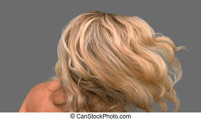 Attractive woman tossing her hair o