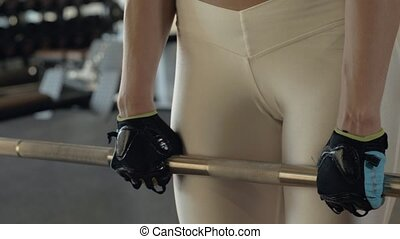 Attractive woman training incline with heavy heavy barbell...