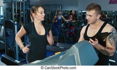 Attractive woman training on a treadmill