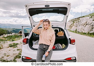 attractive woman travel by car in mountains