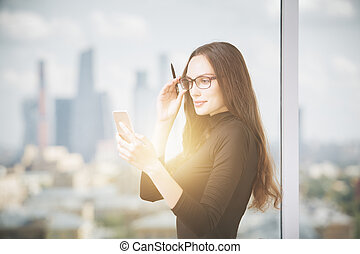 Attractive woman using cellular phone
