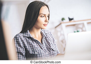 Attractive woman using laptop