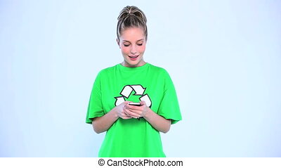 Attractive woman wearing a green t-shirt with recycling...