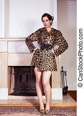 Attractive woman wearing fur coat