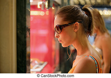 Attractive woman window shopping