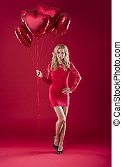 Attractive woman with a bunch of balloons