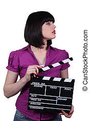 Attractive woman with a clapperboard