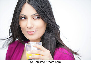 Attractive woman with a glass of orange juice