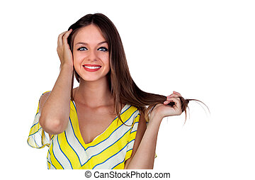 Attractive woman with blue eyes touching her hair