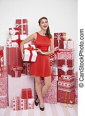 Attractive woman with Christmas present