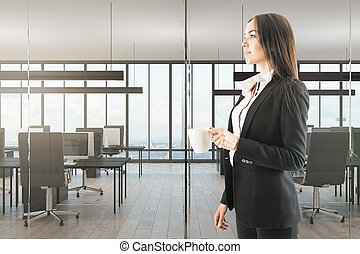 Attractive woman with coffee in office