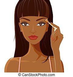 Attractive woman with dark skin applying eyeshadow.