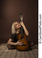 Attractive woman with guitar