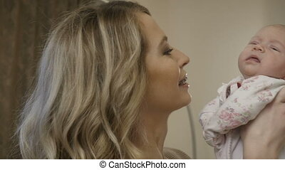 Attractive woman with her baby-girl