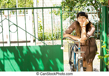 Attractive woman with her bicycle
