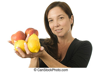 attractive woman with peaches fresh fruit