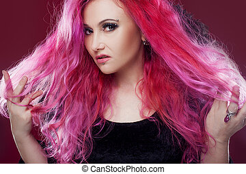 Attractive woman with pink hair in witch image. Halloween style. Angry face