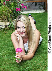 Attractive woman with pink rose
