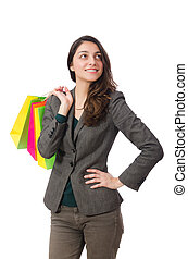 Attractive woman with shopping bags isolated on white
