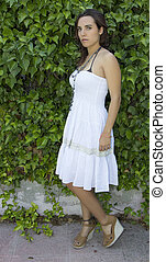 attractive woman with summery white dress
