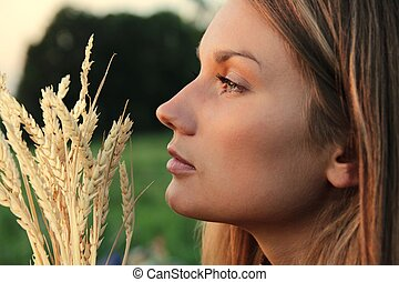 Attractive Woman with wheat spikes