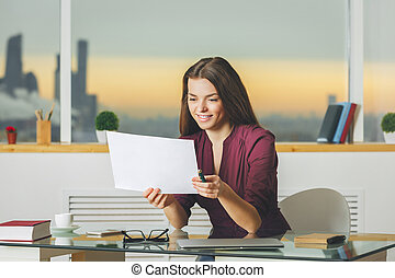 Attractive woman working on project