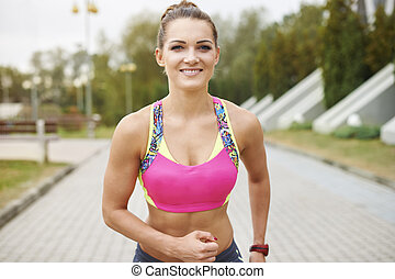 Attractive woman working out outdoors