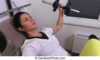 Attractive woman working out with dumbbells