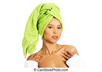 Attractive woman wrapped in towel w
