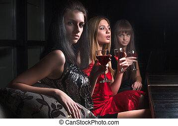 Attractive women relax in cafe