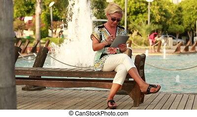 attractive women using digital tablet