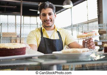 Attractive worker in apron posing - Attractive worker in...